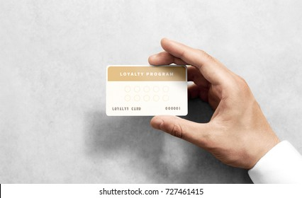 Hand hold loyalty card template with rounded corners.