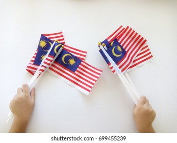 a hand hold malaysia flag isolated on white background