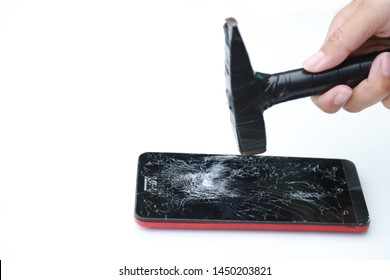 Hand hold metal hammer for destroy smart phone for throw away. manage electronic garbage concept