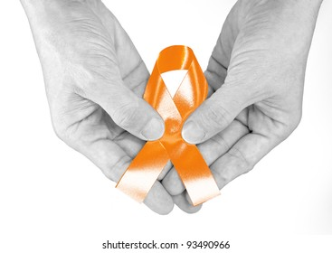 Hand hold orange Ribbon a Symbol of Leukemia
