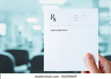 hand hold prescription paper with hospital background