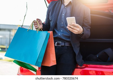 Hand hold smart phone with shopping
