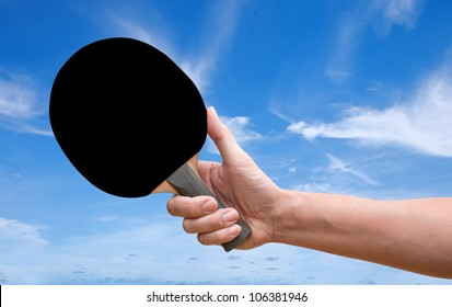 Hand hold Table tennis racket back screen over blue sky