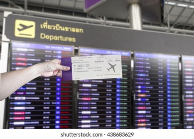 Hand hold ticket with LED screen in airport terminal