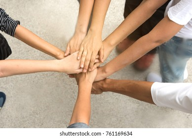 Hand hold together in team for success something or take care.