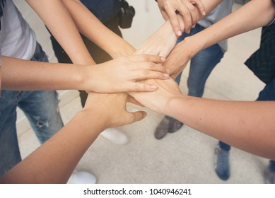 Hand hold togethet in team for success something or take care.