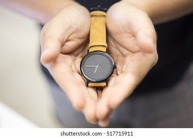 Hand hold vintage wrist watch. Selective focus.