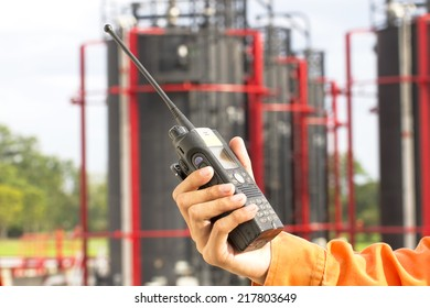 Hand hold walkie talkie on site in plant oil and gas