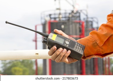 Hand hold walkie talkie on site in plant