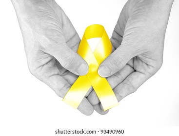 Hand hold yellow Ribbon a Symbol of Bone Cancer