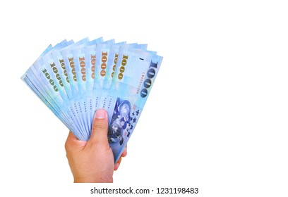 Hand holding a 1000 Taiwan Dollar bill.on white background.
