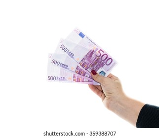 hand holding 500 euro money isolated on white background