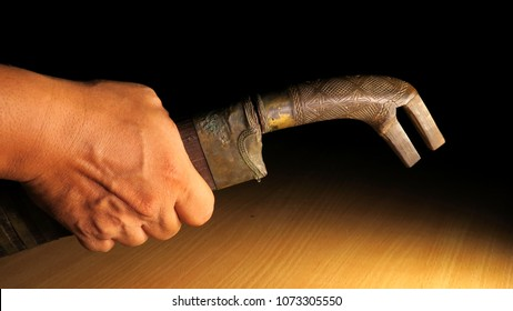 Hand Holding Aceh traditional ancient machete