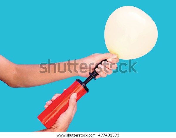 hand holding air balloon pumping