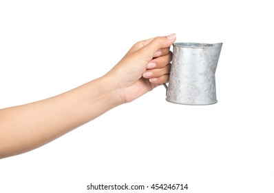 hand holding aluminium watering can isolated isolated on white background