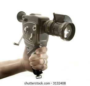 hand holding an amateur cinema camera