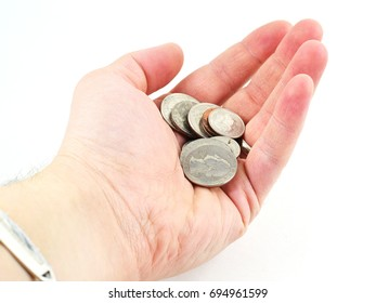 Hand holding American coins (quarter, nickel, dime, penny) - isolated white background
