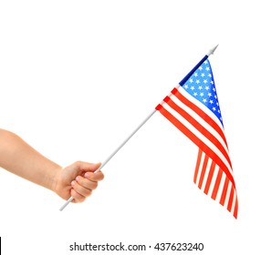 Hand holding American flag, isolated on white