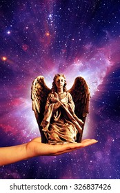hand holding an angel against mystical background