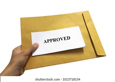 Hand holding  Approved Letter in Brown Envelope Isolated on white background, with clipping path.