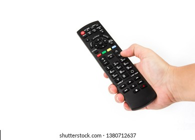 Hand holding audio and television remote control  isolated on white background.