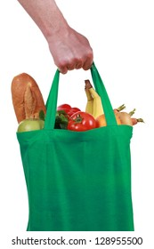 Hand holding a bag filled with groceries, isolated on white