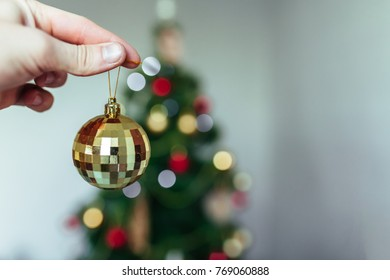 The hand holding the ball. Christmas background. New year. Holiday. Beautiful photo