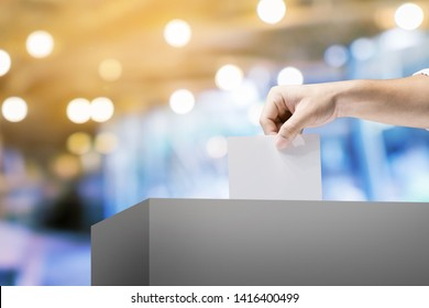 Hand holding ballot paper for election vote concept.