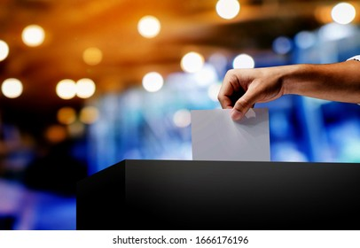 Hand holding ballot paper for election vote concept.Vote is very important for our nation.Everyone do the Vote.