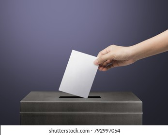 Hand holding ballot paper for election vote concept at place election background.