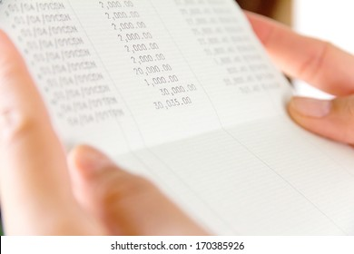 hand holding bank account book,financial concept