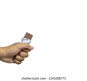 hand holding a bar of milk chocolate on white background.