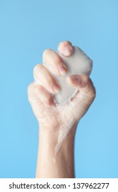 Hand Holding Bar of Soap