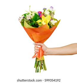 Hand holding a beautiful bouquet of different flowers. Isolated on a white background