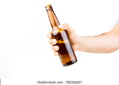 Hand Holding Beer Bottle On White Background Closeup