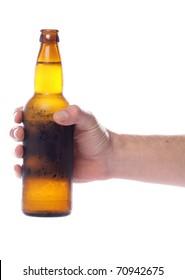 Hand holding beer bottle studio cutout