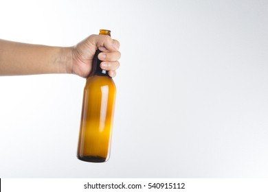 Hand holding a beer bottle without label isolated on white background