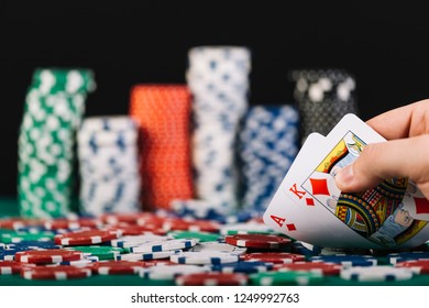 Hand Holding Best Deal Game Cards and Money Chips