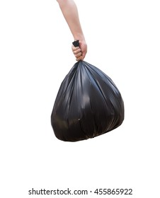 Hand holding black bag of rubbish.isolated on white