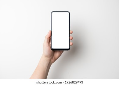 hand holding black mobile phone with white screen isolated on white background - clipping path included
