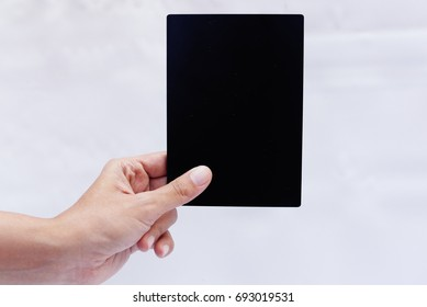 Hand Holding Blank Board Over White Background
