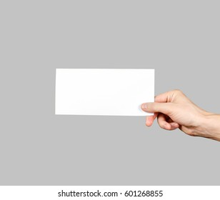Hand holding blank brochure booklet in the hand. Leaflet presentation. Pamphlet hand man. Man show offset paper. Sheet template. Book in hands. Booklet folding design. Fold paper sheet display read