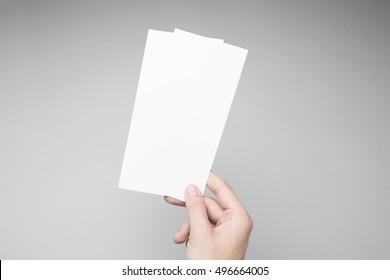 Hand holding Blank DL Flyer / Invitation Mock-up.