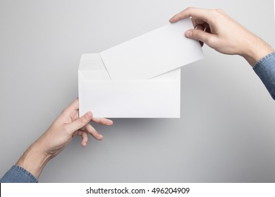 Hand holding Blank Envelope Mock-up, ready to replace your design.