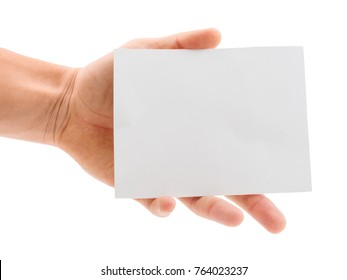 Hand holding a blank paper sheet isolated on white background
