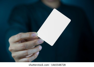 Hand holding  a blank piece of paper. Close up  white business card.