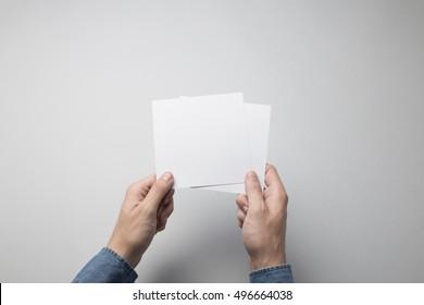 Hand holding Blank Square / Invitation Mock-up.