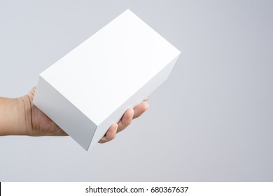Hand holding blank white box give gift on white background