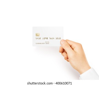 Hand holding blank white credit card mockup isolated. Empty plastic card mock up hold in arm. Clear surface bank card with electronic chip. Debit card concept design presentation template.