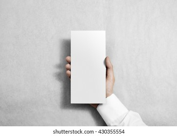 Hand holding blank white flyer brochure booklet. Leaflet presentation. Pamphlet hold hands. Man show clear offset paper. Sheet template. Booklet design sheet display read first person